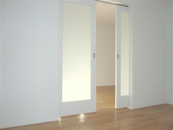 Frosted glass pocket doors for your house seeur for Sliding glass doors nyc