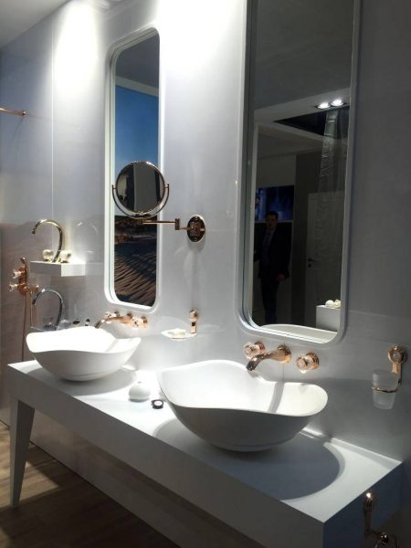 Double bathroom vanity with gold taps and faucets