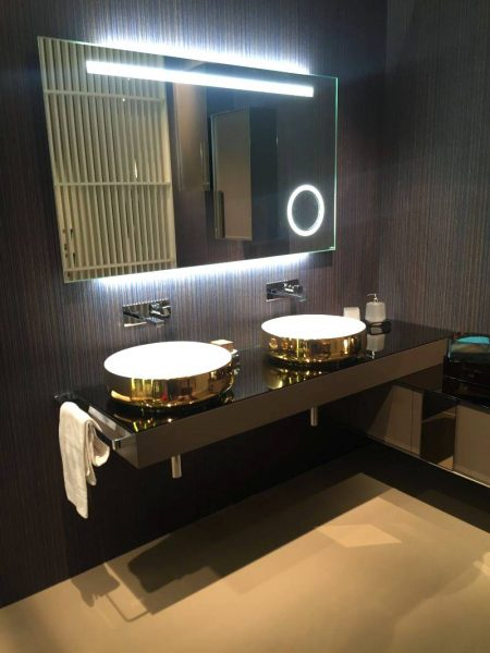 Double sink vanity with gold wash basin
