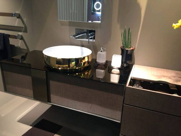 Gold bathroom sink on vanity