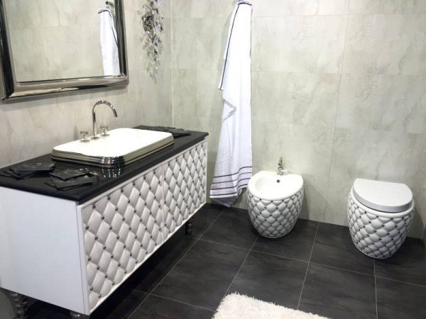 Luxury black and white tufted bathroom vanity and toilet