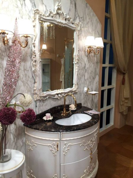 Marble walls and gold accents for bathroom