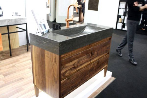 Unk Stone bathroom sink and reclaimed wood vanity