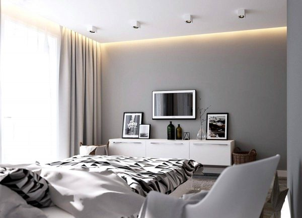 monochromatic bedroom with artwork