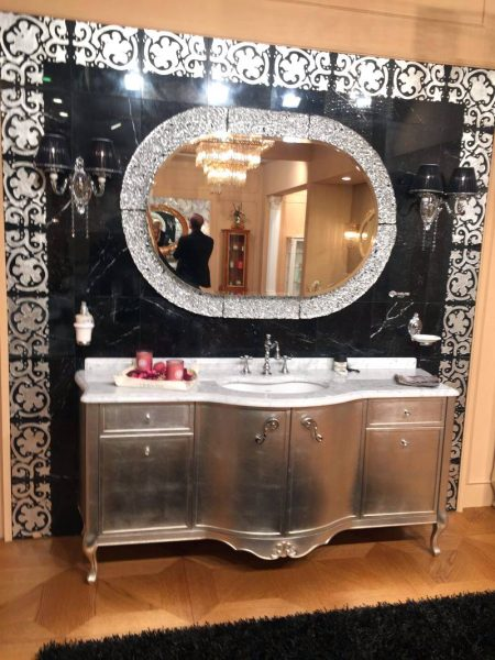 Bronze bathroom vanity with black mirror accents