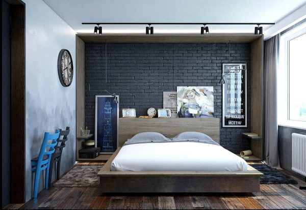 bedroom with brick wall and artwork