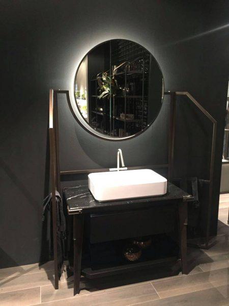 Modern bathroom vanity with black marble on top