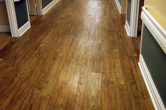 laminate-floor-vs-wood-560x372