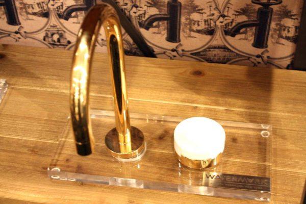 Gold watermark faucet design
