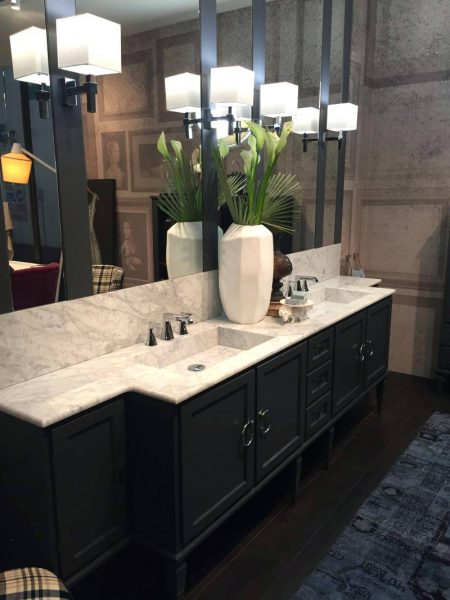 Traditional bathroom design vanity with marble on top and dark vanity