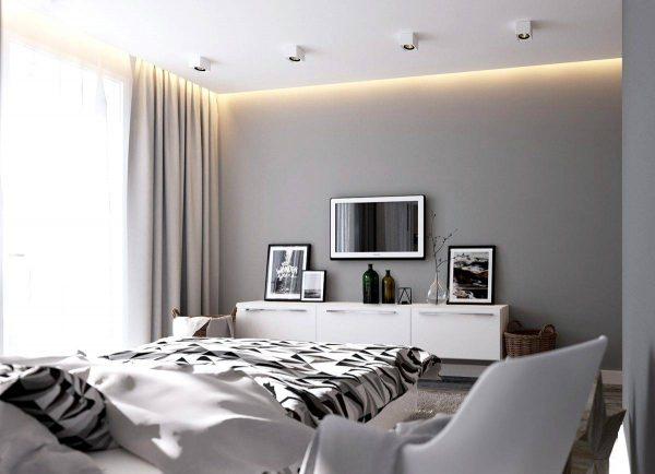 monochromatic bedroom with artwork