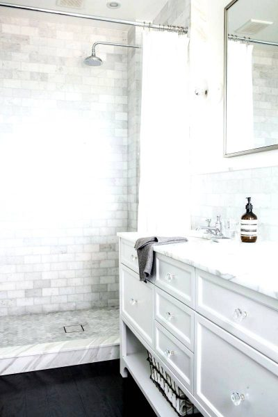 Bright marble walk in shower