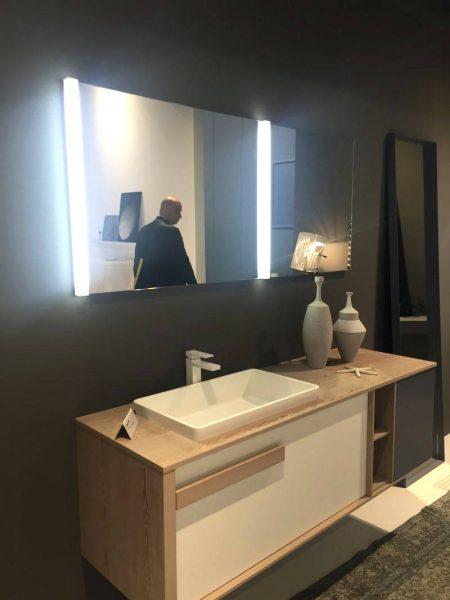 Floating bathroom vanity and a cool mirror with lights