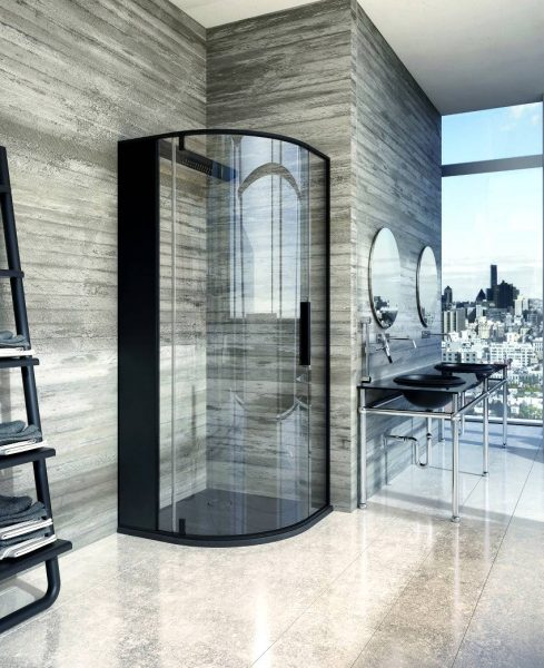 Curved black shower cubicle